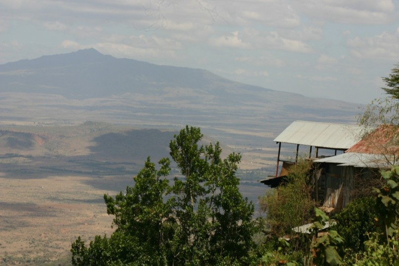 The precipice of a road winding down the foothills of the Abedares into the Rift Valley.