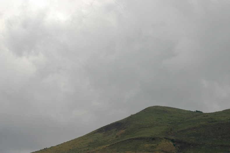 The skies are grey over the rolling farmland of the Rift.