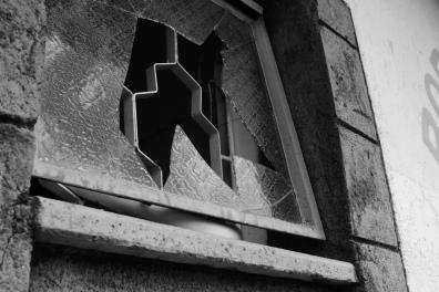 A broken window, a twisted identity.